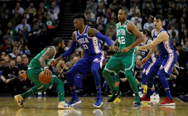 Kyrie Irving, en una acción ante Robert Covington. /Matthew Childs (Reuters)