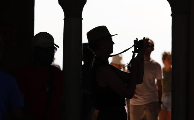 Several tourists visiting Malaga.
